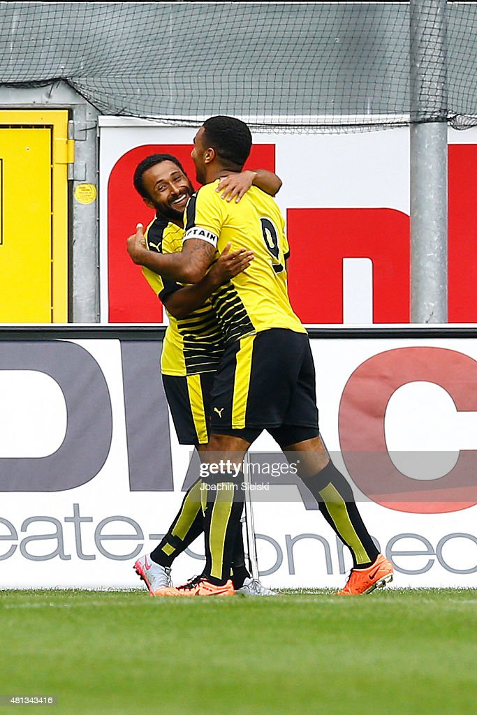 Ikechi Anya and Troy Deeney of Watford celebration their second goal during the pre-season friendly match between SC Paderborn and Watford FC at Benteler Arena on July 19, 2015 in Paderborn, Germany.