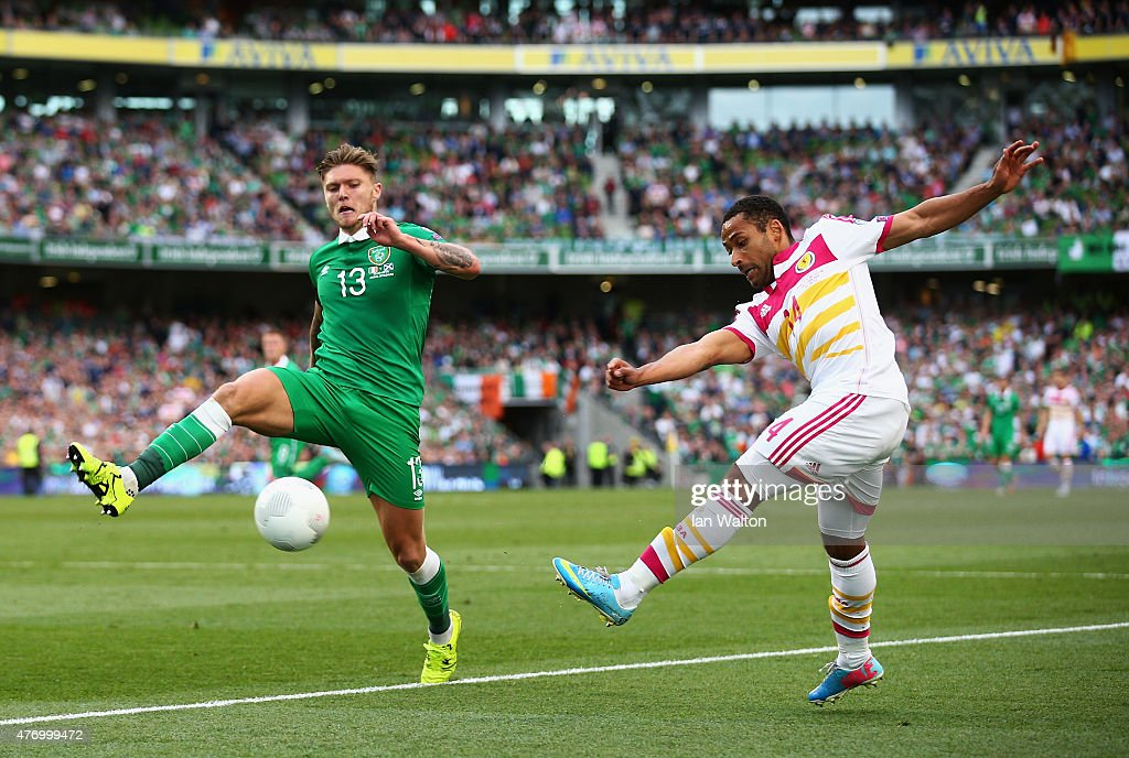 Ikechi Anya of Scotland is closed down by Jeff Hendrick of Republic of Ireland during the UEFA EURO 2016 Qualifier Group D match between Republic of Ireland and Scotland at Aviva Stadium on June 13, 2015 in Dublin, Ireland.