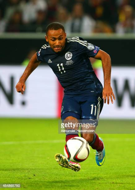 Ikechi Anya of Scotland scores their first goal during the EURO 2016 Group D qualifying match between Germany and Scotland at Signal Iduna Park on...
