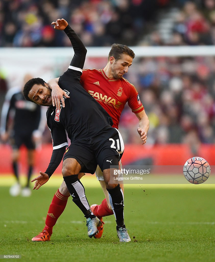 Ikechi Anya of Watford and Chris Cohen of Nottingham Forest compete for the ball during The Emirates FA Cup fourth round between Nottingham Forest and Watford at City Ground on January 30, 2016 in Nottingham, England.