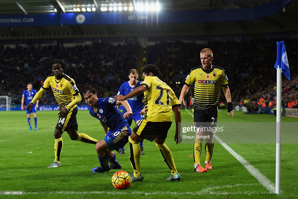 Ikechi Anya of Watford and Shinji Okazaki of Leicester City compete for the ball during the Barclays Premier League match between Leicester City and Watford at The King Power Stadium on November 7, 2015 in Leicester, England.