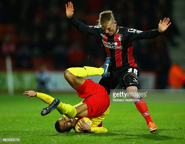 Ikechi Anya of Watford clashes with Matt Ritchie of Bournemouth during the Sky Bet Championship match between AFC Bournemouth and Watford City at...