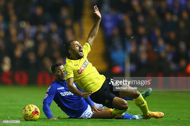 Ikechi Anya of Watford is fouled by David Davis of Birmingham City during the Sky Bet Championship match between Birmingham City and Watford at St...