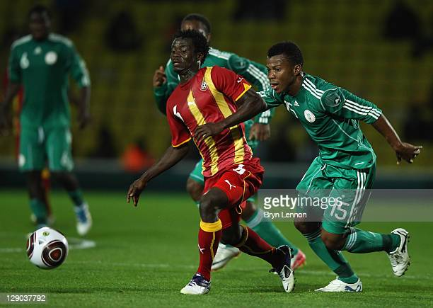Ikechukwu Uche of Nigeria battles with Anthony Annan of Ghana during the International Friendly between Ghana and Nigeria at Vicarage Road on October...