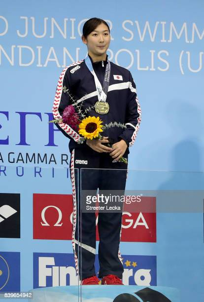 Ikee Rikako of Japan reacts on the podium after winning the Women's 50m Butterfly final during day 4 of the 6th FINA World Junior Swimming...