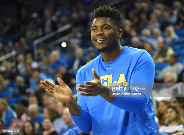 Ikenna Okwarabizie of the UCLA Bruins claps from the bench in the game against the Detroit Mercy Titans at Pauley Pavilion on December 3 2017 in Los...