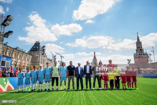 Iker Casillas Alexey Smertin Ronaldo Vladimir Putin Gianni Infantino Lothar Matthaus Carles Puyol and Dmitry Bulykin pose during Football Event in...