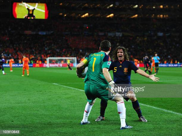 Iker Casillas and Carles Puyol of Spain celebrate victory at the final whistle during the 2010 FIFA World Cup South Africa Final match between...
