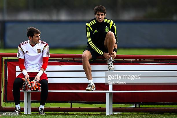 Iker Casillas and Javi Martinez of Spain look on during a training session ahead of their 2014 FIFA World Cup Group B match between Australia and...