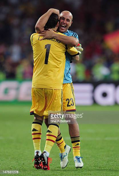 Iker Casillas and Pepe Reina of Spain celebrate their victory after the UEFA EURO 2012 final match between Spain and Italy at the Olympic Stadium on...
