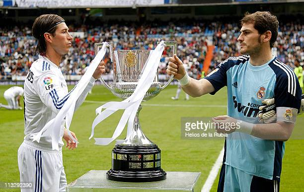 Iker Casillas and Sergio Ramos of Real Madrid hold the recently won Copa del Rey trophy before the La Liga match between Real Madrid and Real...