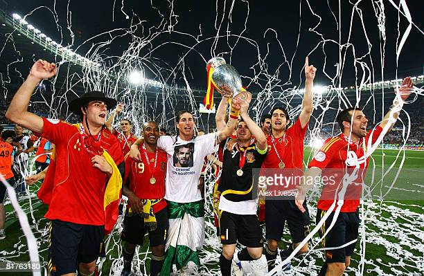 Iker Casillas and Sergio Ramos of Spain lift the trophy with team mates after the UEFA EURO 2008 Final match between Germany and Spain at Ernst...