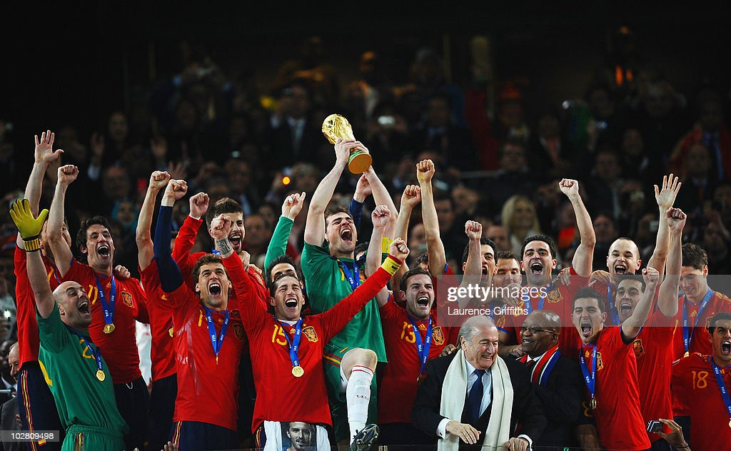 Iker Casillas, captain of Spain (C), and the Spain team celebrate victory with the World Cup trophy during the 2010 FIFA World Cup South Africa Final match between Netherlands and Spain at Soccer City Stadium on July 11, 2010 in Johannesburg, South Africa.