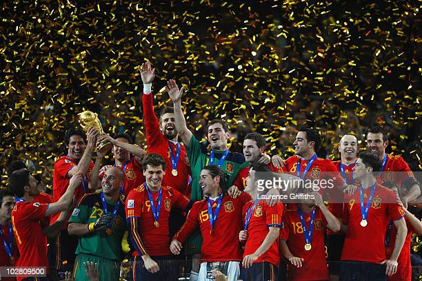 Iker Casillas, captain of Spain , and the Spain team celebrate victory with the World Cup trophy during the 2010 FIFA World Cup South Africa Final...