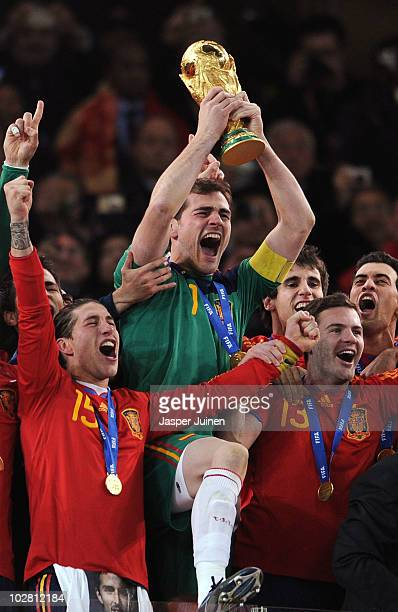 Iker Casillas, captain of Spain , and the Spain team celebrate victory with the World Cup trophy following the 2010 FIFA World Cup South Africa Final...