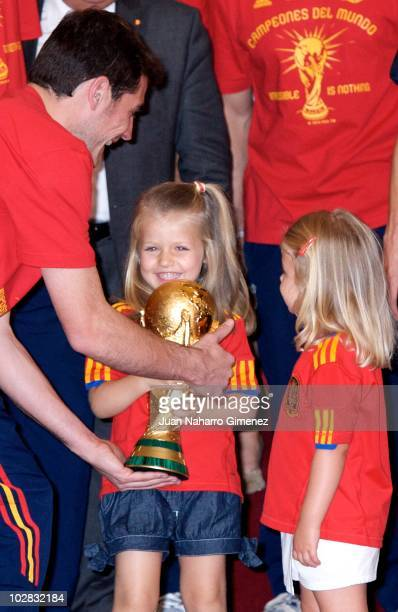 Iker Casillas captain of Spain hands the World Cup to Princess Leonor of Spain and Princess Sofia of Spain as King Juan Carlos of Spain receives the...