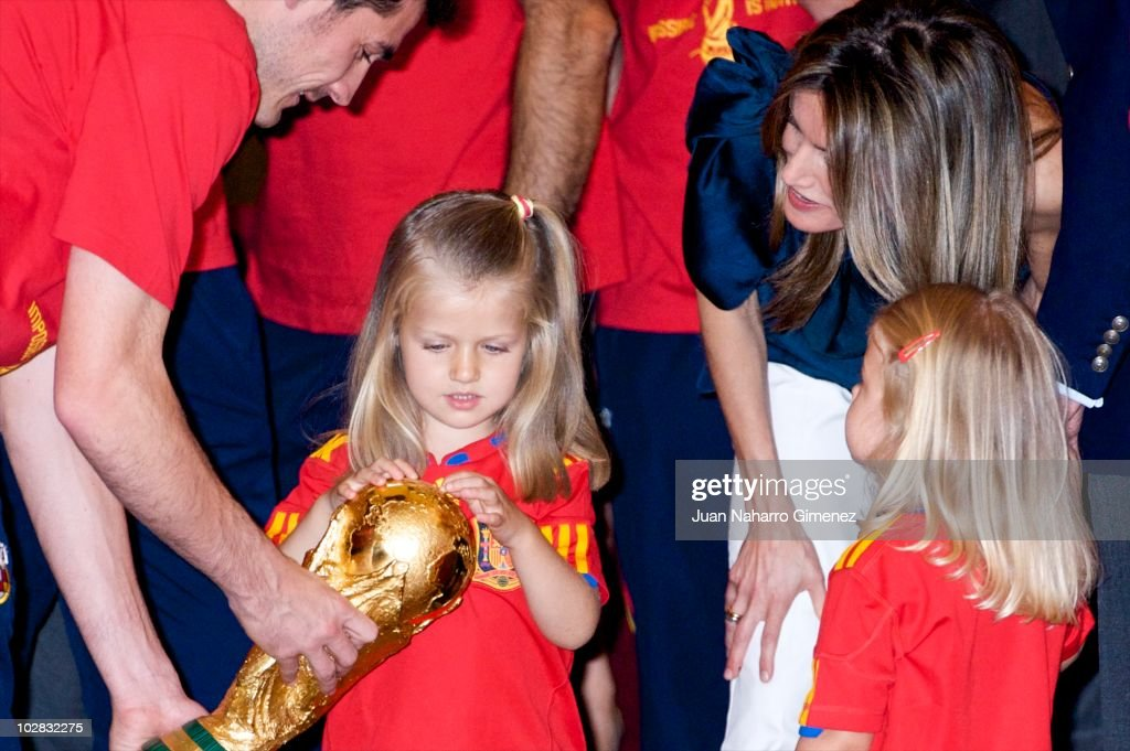 Iker Casillas captain of Spain hands the World Cup to Princess Leonor of Spain while Princess Sofia of Spain and Princess Letizia of Spain watch as King Juan Carlos of Spain receives the Spanish football team fresh from their victory in the 2010 FIFA World Cup at Zarzuela Palace on July 12, 2010 in Madrid, Spain.