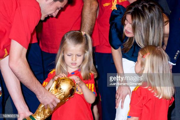 Iker Casillas captain of Spain hands the World Cup to Princess Leonor of Spain while Princess Sofia of Spain and Princess Letizia of Spain watch as...