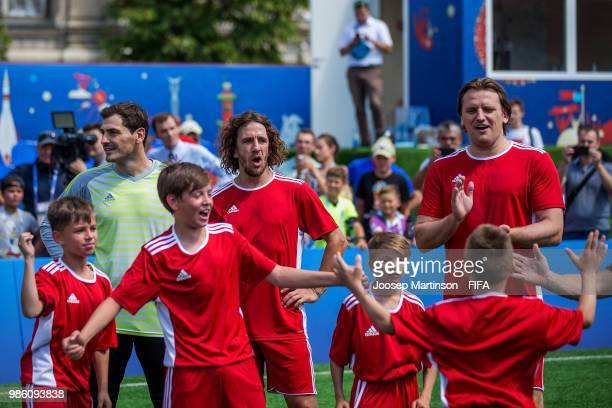 Iker Casillas Carles Puyol and Dmitry Bulykin react with their team during a Football Event at Red Square on June 28 2018 in Moscow Russia