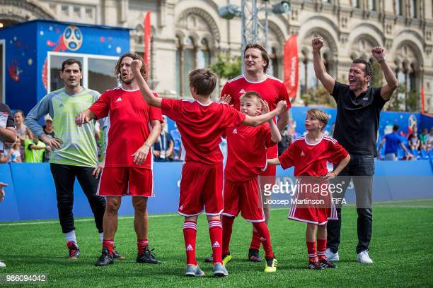 Iker Casillas Carles Puyol Dmitry Bulykin and Lothar Matthaus react with their team during a Football Event at Red Square on June 28 2018 in Moscow...