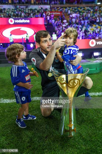 Iker Casillas of FC Porto celebrates wining the Portuguese SuperCup trophy with his kinds after the match between FC Porto and Desportivo das Aves...