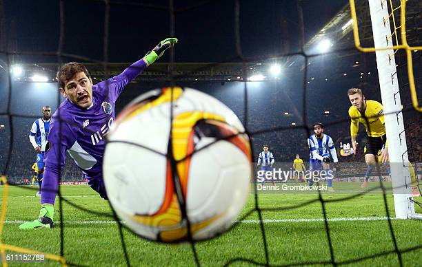 Iker Casillas of FC Porto watches the ball at the back of the net as Lukasz Piszczek of Borussia Dortmund heads the ball to score his team's first...