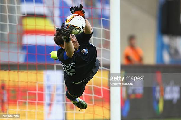 Iker Casillas of Porto saves the decision penalty of Joao Cancelo of Valencia during the Colonia Cup 2015 match between FC Valencia and FC Porto at...