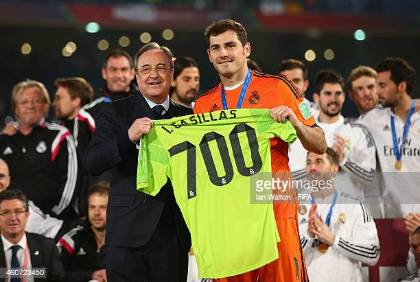 Iker Casillas of Real Madrid celebrates with a special shirt for his 700th official appearance after the FIFA Club World Cup Final between Real...