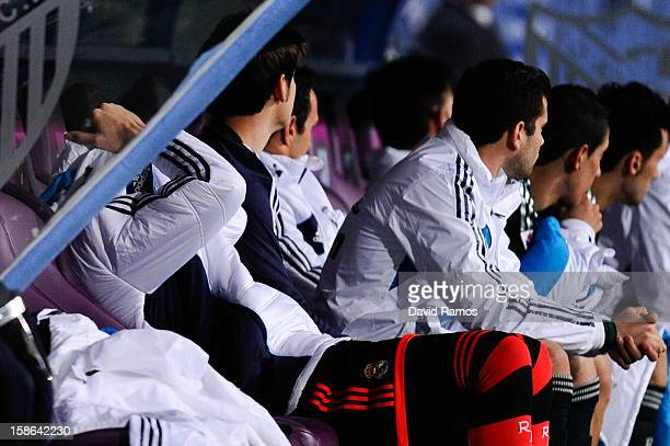 Iker Casillas of Real Madrid CF reacts dejected covering his face under his jacket on the bench after Roque Santa Cruz of Malaga CF scored his team's...