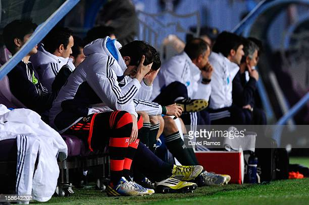 Iker Casillas of Real Madrid CF reacts dejected on the bench after Roque Santa Cruz of Malaga CF scored his team's second goal during the La Liga...