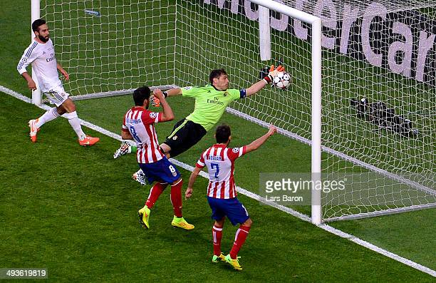 Iker Casillas of Real Madrid fails to stop the ball headed in by Diego Godin of Club Atletico de Madrid for the first goal during the UEFA Champions...