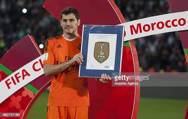 Iker Casillas of Real Madrid holds the FIFA Champions Badge following the FIFA Club World Cup Final match between Real Madrid CF and San Lorenzo at...