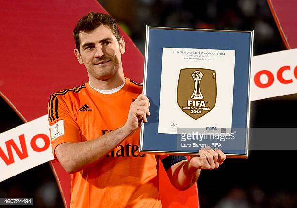 Iker Casillas of Real Madrid receives the FIFA Club World Cup Winners Badge for the team after victory in the FIFA Club World Cup Final between Real...