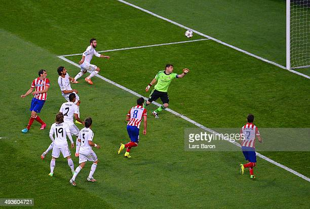 Iker Casillas of Real Madrid watches Diego Godin of Club Atletico de Madrid's head the ball in for the first goal during the UEFA Champions League...