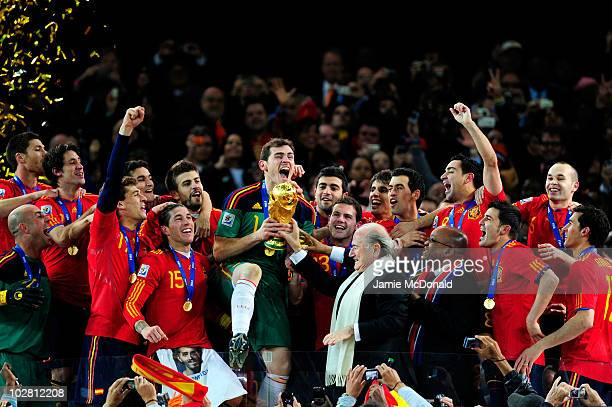 Iker Casillas of Spain celebrates as he is presented the World Cup by FIFA President Joseph Sepp Blatter and President of South Africa Jacob Zuma...