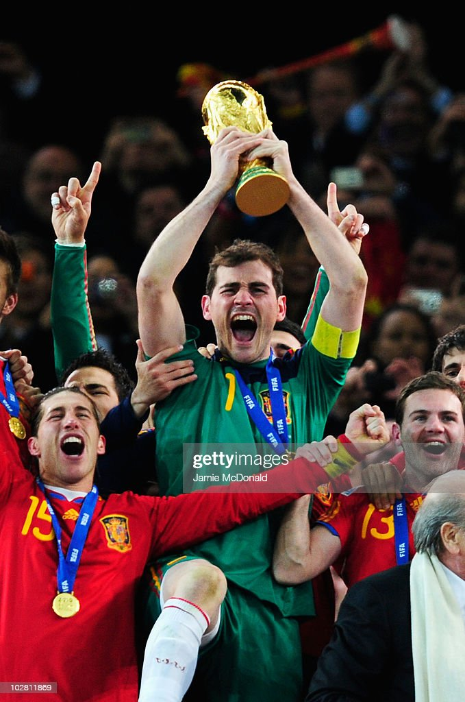 Iker Casillas of Spain celebrates as he lifts the World Cup with team mates during the 2010 FIFA World Cup South Africa Final match between Netherlands and Spain at Soccer City Stadium on July 11, 2010 in Johannesburg, South Africa.