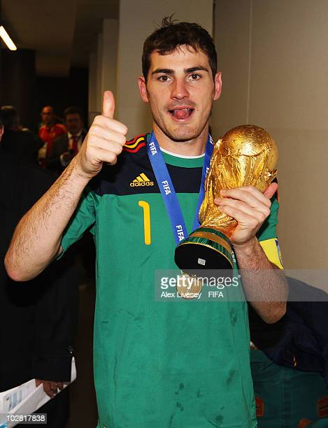 Iker Casillas of Spain celebrates in the Spanish dressing room after they won the 2010 FIFA World Cup at Soccer City Stadium on July 11 2010 in...