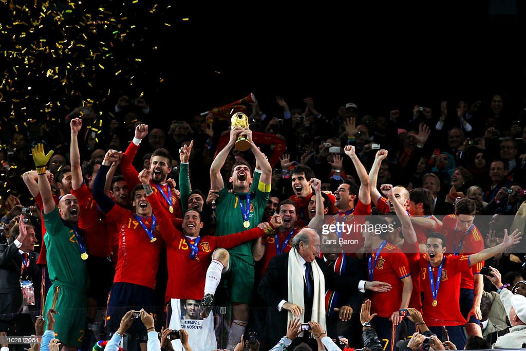 Iker Casillas of Spain celebrates lifting the World Cup with team mates during the 2010 FIFA World Cup South Africa Final match between Netherlands and Spain at Soccer City Stadium on July 11, 2010 in Johannesburg, South Africa.