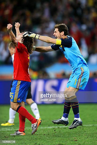 Iker Casillas of Spain celebrates with team mate Carles Puyol after victory and progress to the final during the 2010 FIFA World Cup South Africa...