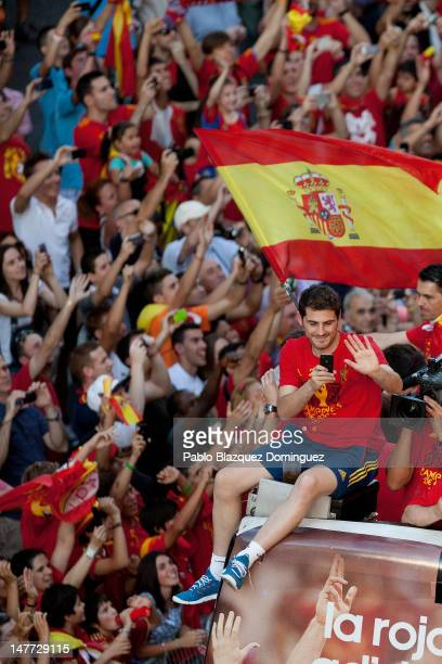 Iker Casillas of Spain celebrates with the UEFA EURO 2012 trophy on a doubledecker bus during the Spanish team's victory parade on July 2 2012 in...