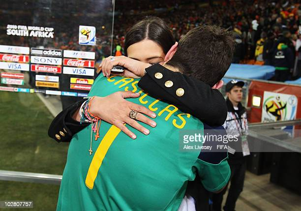 Iker Casillas of Spain hugs TV Presenter Sara Carbonero after the 2010 FIFA World Cup South Africa Final match between Netherlands and Spain at...