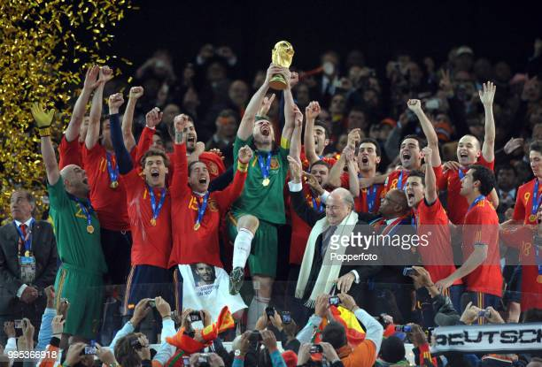Iker Casillas of Spain lifts the trophy and celebrates with teammates after the FIFA World Cup Final between the Netherlands and Spain on July 11...