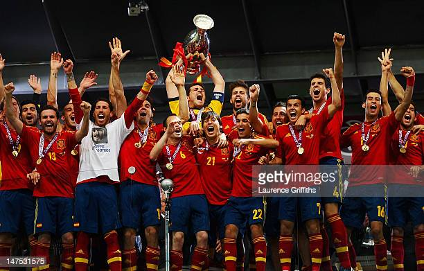Iker Casillas of Spain lifts the trophy as he celebrates following victory in the UEFA EURO 2012 final match between Spain and Italy at the Olympic...