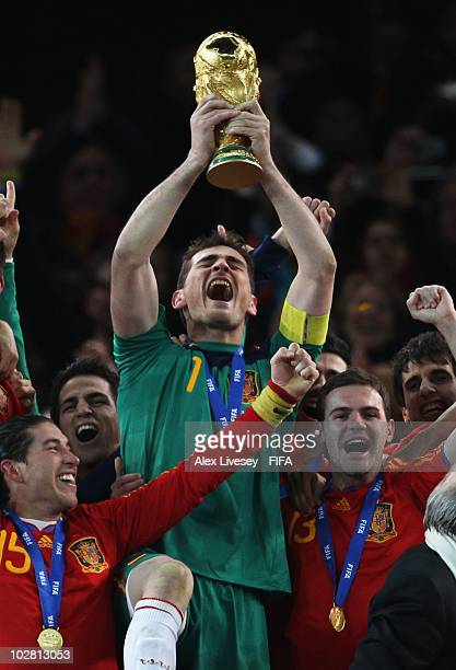 Iker Casillas of Spain lifts the World Cup after the 2010 FIFA World Cup South Africa Final match between Netherlands and Spain at Soccer City...