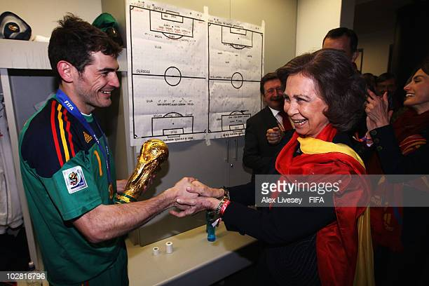 Iker Casillas of Spain poses with Queen Sofia of Spain in the Spanish dressing room after they won the 2010 FIFA World Cup at Soccer City Stadium on...