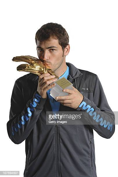 Iker Casillas of Spain poses with the adidas Golden Glove Winner Trophy at the adidas HQ on December 14 2010 in Herzogenaurach Germany
