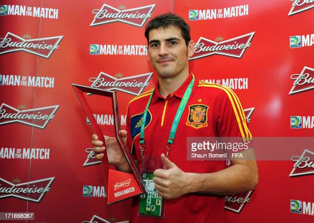 Iker Casillas of Spain poses with the Man of the Match award after the FIFA Confederations Cup Brazil 2013 Semi Final match between Spain and Italy...
