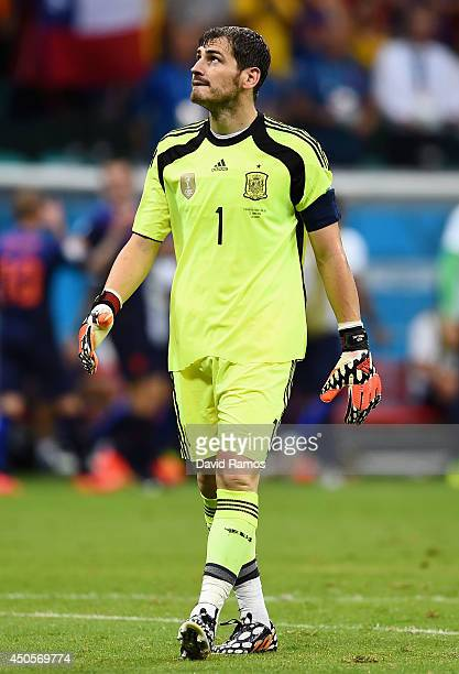 Iker Casillas of Spain reacts after allowing the third goal during the 2014 FIFA World Cup Brazil Group B match between Spain and Netherlands at...