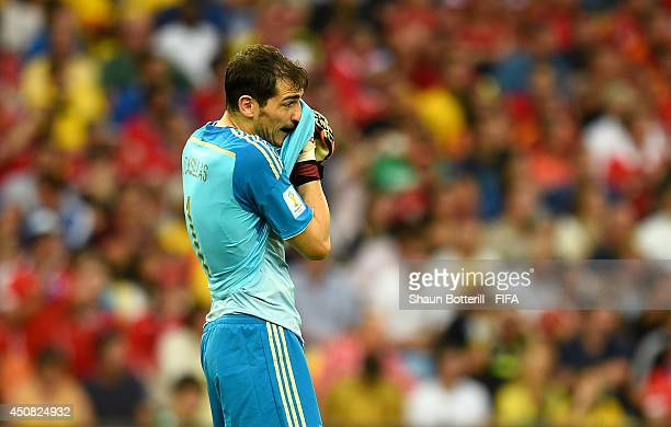 Iker Casillas of Spain reacts after Chile's second goal during the 2014 FIFA World Cup Brazil Group B match between Spain and Chile at Estadio...