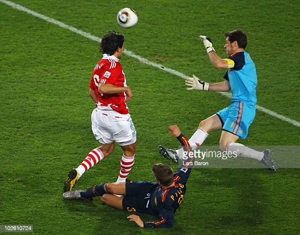 Iker Casillas of Spain saves a goal scoring chance by Roque Santa Cruz of Paraguay during the 2010 FIFA World Cup South Africa Quarter Final match...